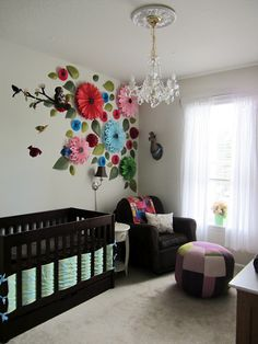 "Use this idea to transfer Hudson's boy themed frog nursery into a nursery more suited for a little girl using the coral flowers on their ""ears"""