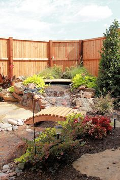 Soothing water fall with seating area in your own back yard.