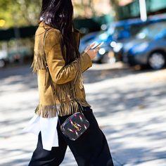 suede fringe jacket with a YSL lipstick bag
