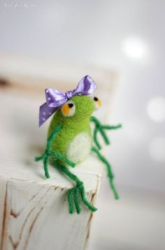 This little needle felted frog was born in Sofia a few days ago. She is made of pure wool and had a purple ribbon with dots. She is little but and not afraid of storks. I use felt needle techniques and 100% pure wool form Bulgaria. I dye the wool by myself to achieve the right colors. Size in centimeters: 5 cm high Size in inches: 1.9 high Each of my dolls are: Created with love. Handmade by me. My own model. Made of 100% sheep wool. I make all my items with love and I hope youll like the...