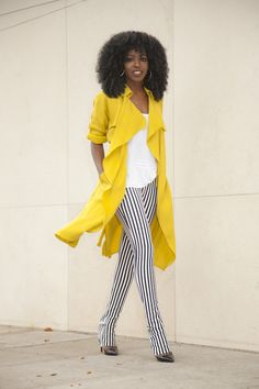 Love the combination of the amazing yellow coat with the vertical striped pants