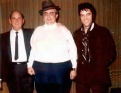 Elvis in L-A in december 19 1968,here with his manager Tom Parker and his friend Lamar Fyke.