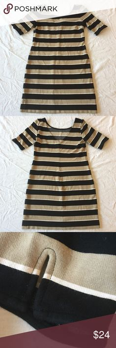 """.Banana Republic. Striped short-sleeve mini dress Striped short-sleeve mini dress from Banana Republic. Boat neck in front, v in back. Cute dart details on sleeves (see closeup). Black, tan, and white stripes. Some minor pilling under arms, otherwise EUC. Size petite XS. Laying flat, armpit to armpit 16.5"""". Length 30.5"""". Super cute with leggings year-round! B. Banana Republic Dresses Mini"""