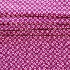 Katoen stof met witte stippen op roze achtergrond