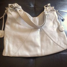 Pale lilac calfskin shoulder bag in like new condition and includes superior quality dust bag.. Retails over $900