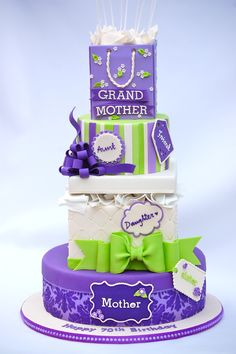 """Stack of Gift Boxes - A 70th birthday cake for Esther who is mother, grandmother, daughter, sister, wife, cousin, aunt and friend to so many! 11"""" round, 7"""" square, 6"""" round and 4"""" rice crispy treats gift bag. The cake stood 2ft tall!"""