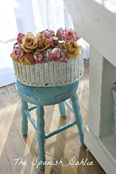 Pretty blue stool with roses in white basket