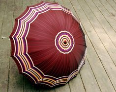 Vintage Umbrella Striped with Plastic Handle by CalloohCallay on Etsy https://www.etsy.com/listing/79137333/vintage-umbrella-striped-with-plastic