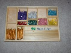 Homemade Montessori: Bead Stair.  She gives the amounts and colors of beads for each number.