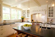 """Frankly modern in function, the new kitchen has a traditional look: a stove """"hearth,"""" subway tile, and beautiful millwork."""