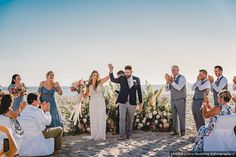 Beach wedding couple photography, blue bridesmaid dresses