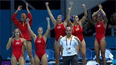 Spanish players celebrate winning the Women's Water Polo semi-final match between Spain and Hungary at the Water Polo Arena