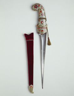 Peshkabz Dagger - Dated: circa 18th century - Culture: Indian - Medium: steel, gold, jade, rubies, diamonds, emeralds, and velvet covered wood - Measurements: 44.7 x 7.5 x 3.0 cm (whole object) - Acquirer(s): King Edward VII, King of the United Kingdom (1841-1910) - Provenance: presented to King Edward VII, when Prince of Wales, during his tour of India in 1875-76 by Shivaji V Chhatrapati Narayana Rao, Raja of Kolhapur