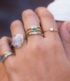 This unique and stunning combination of emeralds, opals, and diamonds is breathtaking.The emerald's bold jewel tone adds the perfect pop of color. The diamonds and opal adds sparkle and shimmer. Opal