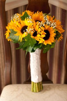 Sunflower, Baby's Breath and Ivy Bouquet - Warmth and Happiness: 20 Perfect Sunflower Wedding Bouquet Ideas - EverAfterGuide