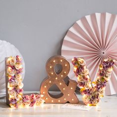Flower Initial Letter Lights With Solid Ampersand. Handmade to order, you will receive your two chosen #flower initials plus a light up ampersand (&). Colour shown in the picture is Purple and Cream but I can tailor the flowers to any colour scheme. #Lights #Wedding