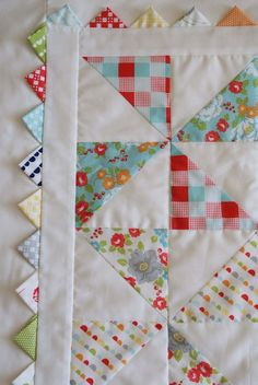 Incorporate triangles (prairie points) into the quilt binding border! Would be cute for a kid's quilt.I love the prairie points and pinwheels on this baby quilt.'Pinwheel Baby' Quilt by Jodi Nelson (Moda Bake Shop) using 'Happy-Go-Lucky' fabrics by M Cute Quilts, Scrappy Quilts, Easy Quilts, Mini Quilts, Patchwork Quilting, Owl Quilts, Quilting Fabric, Quilting Tutorials, Quilting Projects