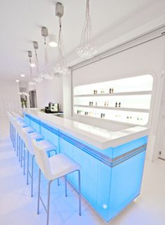 Squash Sports center with Fresh Lighting by Kreacja Przestrzeni, futuristic interior, minimal, light blue, futuristic bar, white room