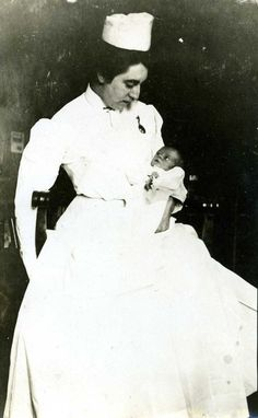 Real photo postcard of unidentified nurse with newborn baby. The photo appears to have been taken in the late 1800s or early 1900s.