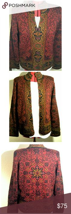 """Vtg. 100% Alpaca Cardigan Sweater Absolutely gorgeous...is this soft, hand loomed, 100% alpaca fiber cardi in warm, fall colors.  The unique floral-like pattern has a contrast border on the collar, cuffs, front, and lower edge.  Shoulder pads! **No issues!!* *Muted maroon, harvest gold, olive, and black colors.*  Dakota, tag size MEDIUM, may best fit a modern S/M,  but please use measurements for best fit. 16"""" across shoulders, 19.5"""" armpit to armpit (39""""), 24"""" length from shoulder to hem…"""