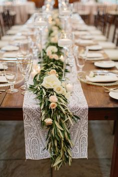 erin mcginn; castle hill inn; newport wedding; newport; outdoor ceremony; ceremony by the sea; tented reception; white green and wood table scape; table runner of greenery; glass beaded charger plates; gold rimmed wine glasses; tall glass candle holders;