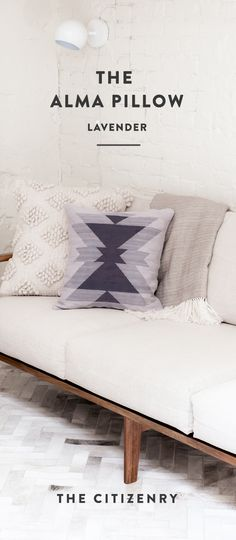 Soft lavender gets a bold look in this hand-loomed accent pillow. Designed in a sharp, structural pattern, this pillow brings a modern feel to any space.