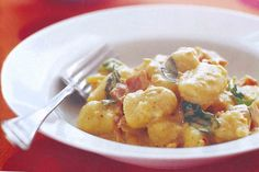 Creamy gnocchi with bacon and pesto main image