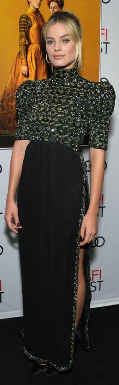 f926c0d49677 Who made Margot Robbie s black gown and pumps  Dress – Chanel Shoes – Jimmy  Choo