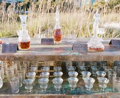party bar in a field with decanters and glasses