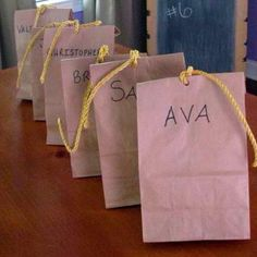 Indiana Jones themed party favor bags. Paper bags filled with favors and tied with rope.