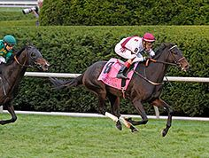 Crown Queen, a half sister to champion Royal Delta, earned her first grade I victory with a sparkling late run in the $500,000 Queen Elizabeth II Challenge Cup Presented by Lane's End (gr. IT) at Keeneland Oct. 11, 2014.