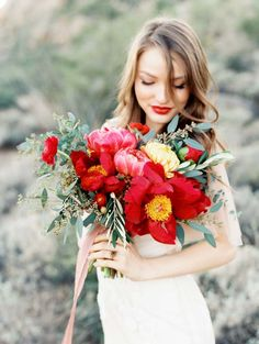 Desert bridal shoot with red peony bouquet