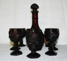 """9 pc Vintage Avon's """"1876 Cape Cod"""" Ruby Red Wine Decanter & 8 Goblets 1970s by PeggysVintageVariety on Etsy"""