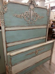 Antique bed painted with French Blue and Creamy Linen Farmhouse Paint.  Next Tea Stain Antiquing Gel and then Gold Shimmer. All prouducts by Farmhouse Paint.  www.farmhousepaint.com
