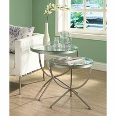 @Overstock.com - Satin Silver 2-piece Nesting Table Set with Tempered Glass - Serve up a snack or set down your favorite reading materials on this set of two cute metal nesting tables with circular glass tabletops and a satin silver finish. The tables can be nested together when they arent in use to save space.  http://www.overstock.com/Home-Garden/Satin-Silver-2-piece-Nesting-Table-Set-with-Tempered-Glass/6811143/product.html?CID=214117 $135.41