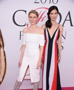 Gabriela Hearst and Tao Okamoto in Gabriela Hearst, M2Malletier bag, and Monique Péan jewelry