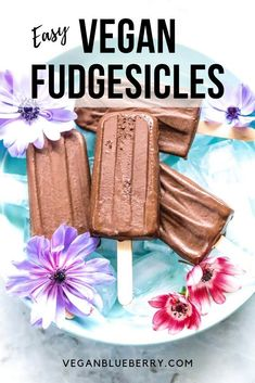 These ultra creamy Vegan Fudgesicles are so easy to make with just 4 ingredients! Created with a coconut milk and cocoa powder base. Aside from a simple popsicle mold, this healthy recipe requires no actual cooking or fancy tools!! Gluten-free, dairy-free, and refined sugar-free. #veganrecipes
