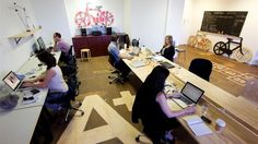 Cheap and simple. One long desk allows for flexible space per person