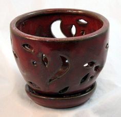 "Ceramic Orchid Pot/Saucer 5 3/4"" x 4 3/8"" - Tropical Red by Hirts: Pots. $9.99. Tropical Red with attached saucer/humidity tray. Great for most orchids. 5 3/4"" x 4 3/8"". Attractive Design. Heavy Glazed Ceramic Pot. These orchid pots are as functional as they are beautiful. They are crafted with unique patterns carved into them for proper air ventilation to your root system, essential for thriving orchids. With a variety of shapes, patterns, and color glazes. Heavy Glazed Ceramic Pot."