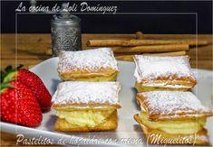 Pastelitos de hojaldre con crema pastelera (Miguelitos). Los miguelitos son unos pastelillos típicos de la localidad albaceteña de La Roda hechos a base de fino hojaldre, rellenos de crema pastelera y espolvoreados con azúcar glasé. Receta en mi Blog: http://lacocinadelolidominguez.blogspot.com.es/2015/02/pastelitos-de-hojaldre-con-crema.html Videoreceta en You Tube: https://www.youtube.com/watch?v=ztvsQb_KNNU