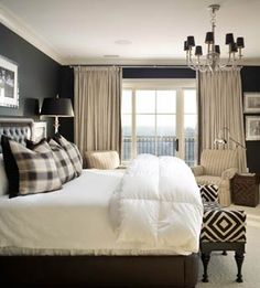 love the dark walls in this bedroom and the accent pillows / bench