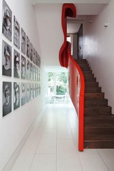 Quirky staircase design! organic - and a dazzling scarlet red set against a formal, white interior!