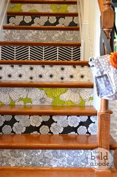 Decorate stair risers with removal wallpaper. (THIS WOULD BE SO FUN ON THE BASEMENT STAIRS)