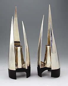 Pr Moderne Hand Wrought Sterling Candlesticks / A pair of modern 1960's candlesticks on ebony feet with three cathedral like spires and a candle holder at the center of each unit.