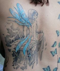 fairy with blue wings tattoo