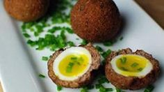 Mini eggs wrapped in meat and deep fried!