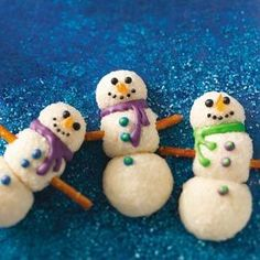 Snowman Christmas Cookies Recipe from Taste of Home -- While my family loves the subtle cheesecake flavor of these cookies, I like the fact that I don't need to use a cookie cutter to shape them.  —Cathy Medley, Clyde, Ohio.