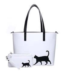 NEW FEATURES! The Cat Walk Tote features a happy cat walking with their tail up and curled! The Cat Walk Tote Trio was designed by Triple T Studios and is made exclusively for us. The back of the tote features a whimsical trail of cat paws creating a pretty pattern across the bag. The cat and the cat paws are carefully stitched in place. We added a hidden magnetic snap closure instead of a zipper for a more streamlined look. Winter White with black cat and cat paws. Black trim inside top…