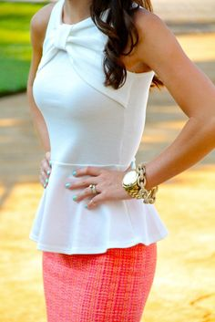 White peplum bow top, pink and coral tweed pencil skirt, and gold stacked jewelry.