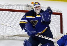 St. Louis Blues goalie Brian Elliott is unable to control the puck during the second period of an NHL hockey game against the Winnipeg Jets Tuesday, Feb. 9, 2016, in St. Louis. After Elliott lost control, Jet's Bryan Little was able to knock the puck in for a goal. (AP Photo/Jeff Roberson)